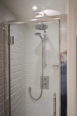 The stand alone shower in the bathroom