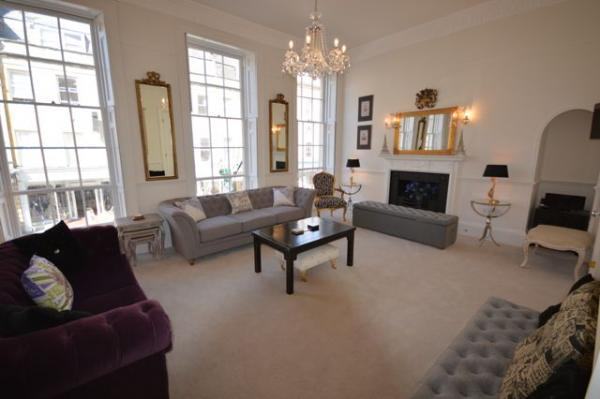 The drawing room with purple sofa bed