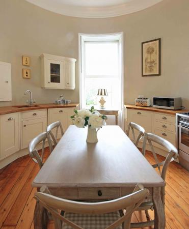 The dining table in the heart of the kitchen