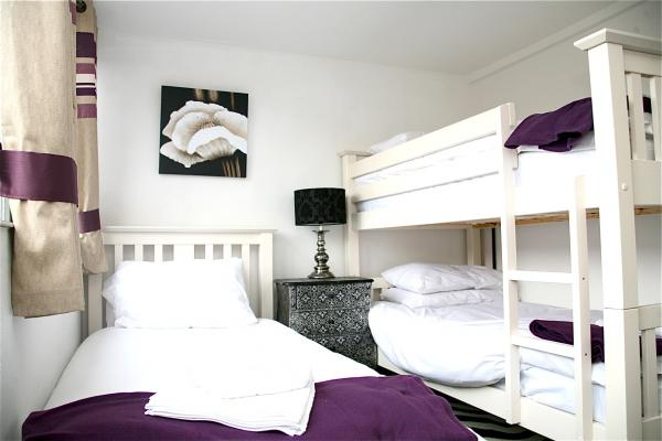 2 smaller bedrooms  - sleep 3 with girly bunk beds!