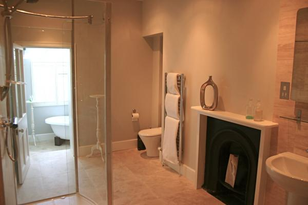 The large shower room leads to the lovely Bath