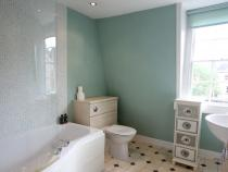 Bright Bathroom With Shower Over Bath
